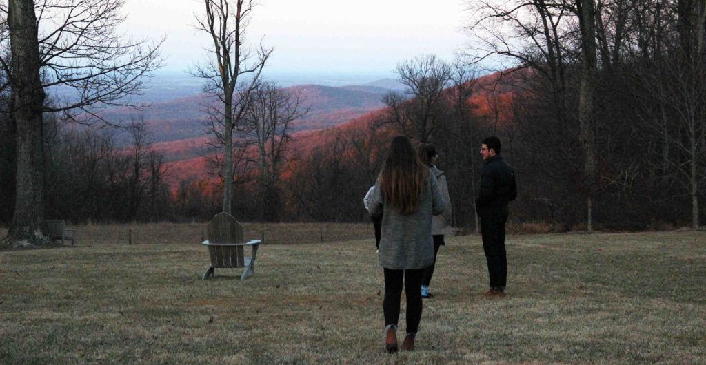 Students outside at Contemplative Center during the Spring, at sunset