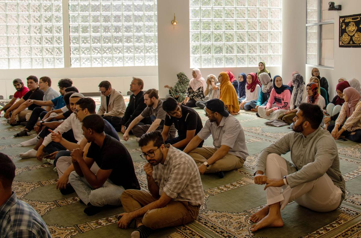 Students with Imam Hendi in prayer room
