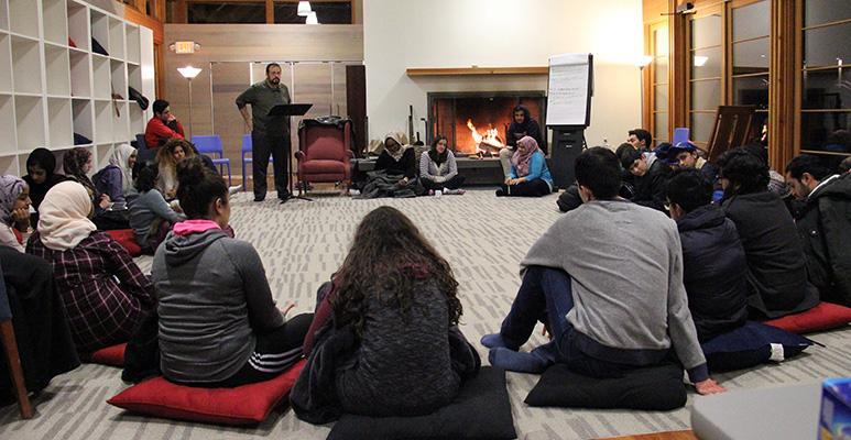 Imam Hendi leading a discussion with students