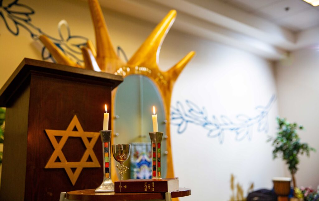 Jewish community space with arc and candles
