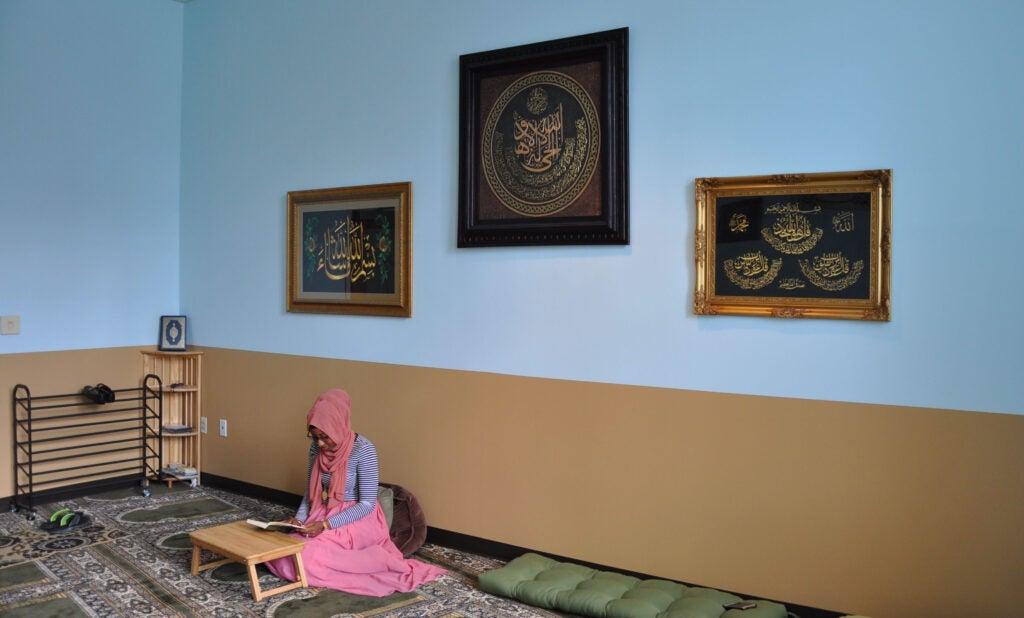 Woman praying in law center muslim prayer room